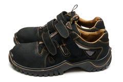 Gli stivali del lavoro è su fondo bianco Fotografia Stock Libera da Diritti