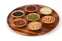 Gli strappi del lavoro, fagioli della soia, fagioli rossi, fagioli neri, arachide, pinolo, mandorla e fagiolini Fotografia Stock