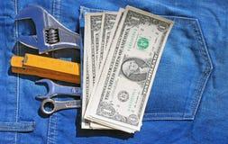 Gli strumenti e incassano la tasca Immagini Stock Libere da Diritti