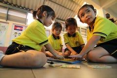 Gli studenti di asilo stanno imparando Immagine Stock Libera da Diritti