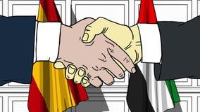 Gli uomini d'affari o i politici stringono le mani contro le bandiere della Spagna e dei UAE Riunione ufficiale o fumetto relativ royalty illustrazione gratis