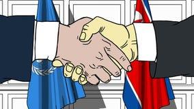 Gli uomini d'affari o i politici stringono le mani contro le bandiere delle nazioni unite e della Corea del Nord Riunione o coope illustrazione di stock