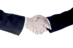 Gli uomini di affari agitano le mani che portano i guanti protettivi Immagine Stock