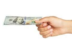 Gli uomini passano a tenuta cento banconote in dollari su bianco Fotografia Stock