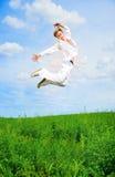 Gli uomini saltano Immagini Stock