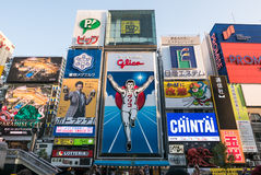 `Glico Man` billboard icon Osaka. `Glico Man` billboard icon along Dotonbori-gawa canal. Some of the best street food could be found here. This area is an Royalty Free Stock Images