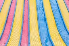 Glidaren i en variation av färgar arkivbilder