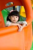 Glidbana för barnspelrum på lekplatsen Arkivbilder