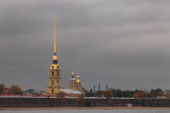 Glided cupola of Peter and Paul Cathedral agains gray moody sky Stock Image
