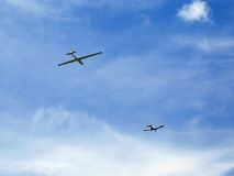 A glider. A plane dragging a glider Stock Images
