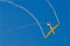 Glider. With smoke trace on blue sky Stock Image