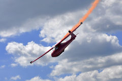 Glider aerobatic flying in the sky Stock Photos