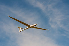 Glider. A glider against a blue sky Royalty Free Stock Photography