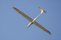 Glider against blue sky Royalty Free Stock Images