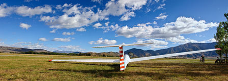 Glider on airfield. A glider is waiting for the tow plane on an airfield at Omarama, Central Otago, in the South Island of New Zealand. Omarama is the mecca for Stock Images