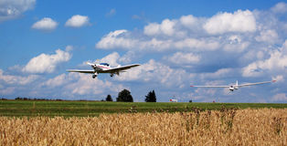 Glider going up. Glider takes off from field airport Royalty Free Stock Image
