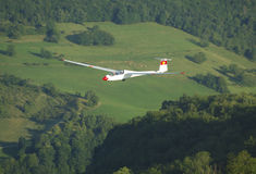 A glider Janus flying over Challes les eaux Royalty Free Stock Photography