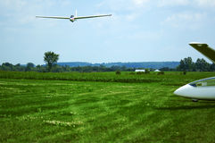 Glider Landing. A glider coming in for a landing with another glider parked on the side Royalty Free Stock Photography