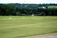 Glider landing on a local sports plane airport Stock Images