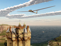 Glider over a Scottish castle Royalty Free Stock Image