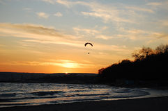 Glider over the sunset. At the seaside royalty free stock image