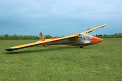 Glider plane on grass Royalty Free Stock Image