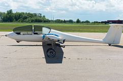 Glider Plane and Open Canopy on Airstrip Stock Photo