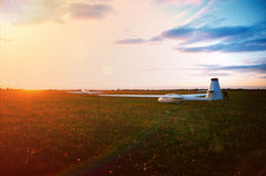 Glider prepared for take off at sunset Stock Image
