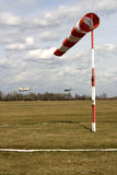 Glider pulled above an airfield. The wind sleeve blows Royalty Free Stock Images