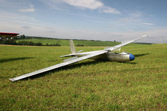 Glider ready to fly. The glider on the country aerodrome in the field ready to fly Royalty Free Stock Image