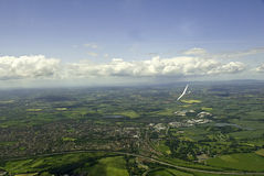 Glider soaring over English countryside. Royalty Free Stock Image