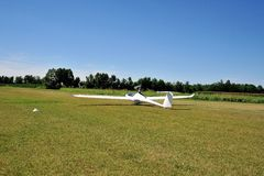 Glider taking off from runway Royalty Free Stock Images