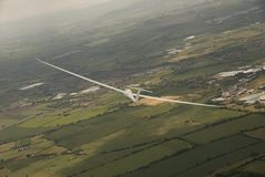 Glider turning in flight over rural England Stock Photography