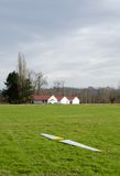 Glider wings lying on field near Carnation. Waiting for assembling Royalty Free Stock Photo