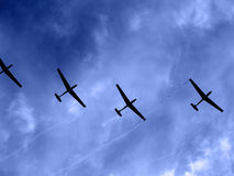 Gliders. A gliders shot from below against a blue sky Royalty Free Stock Photos