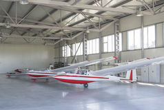 Gliders in air dock. Three light gliders stationed in an air dock Stock Photo