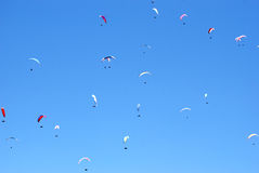 Gliders of the background of blue sky. A lot of paragliders of the background of blue sky Stock Photos