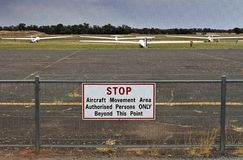 Gliders parked on the grass at Temora aerodrome. Gliders parked on the grass alongside the runway at historic Temora aerodrome, NSW, Australia stock photography