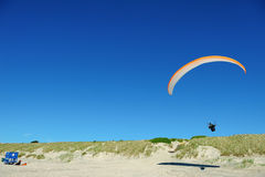 Gliding above beach Stock Images
