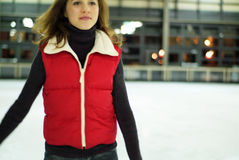 Gliding girl. Teenage girl ice skating at indoor rink stock images