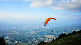 Gliding. Glider fly over the city of Geneva. Flight began from mountain Saleve. Early autumn. Switzerland Stock Image