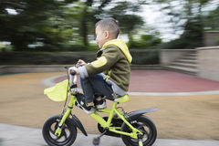 Kid on bicycle gliding. One boy riding on bicycle gliding down from ramp Royalty Free Stock Photo