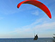 Gliding over Ocean. Parachute gliding over sea Stock Photography