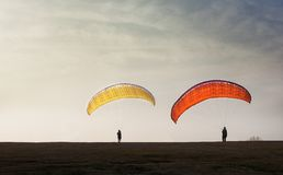 Gliding parachute. Glidings, including hang gliding and paragliding, are gaining popularity both as competitive and spectator sports Royalty Free Stock Photography