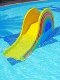 Glijbaan in pool stock fotografie