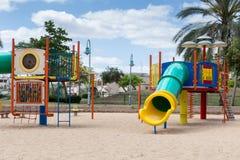 Glijbanen en speelplaatsen Speelplaatspark Stock Foto's