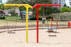Glijbanen en speelplaatsen Speelplaatspark Stock Foto