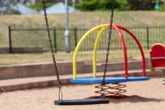 Glijbanen en speelplaatsen Speelplaatspark Stock Afbeelding