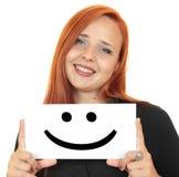Glimlach. Glimlachende jonge vrouw die witte banner steunen Royalty-vrije Stock Foto's
