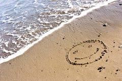 Glimlach in het Zand Stock Afbeeldingen